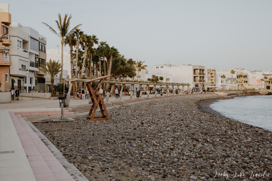 promenade and city beach in Arinaga