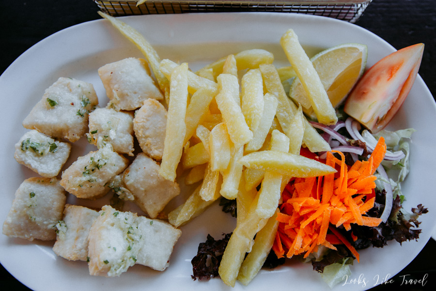 fish cubes with fries and vegetables